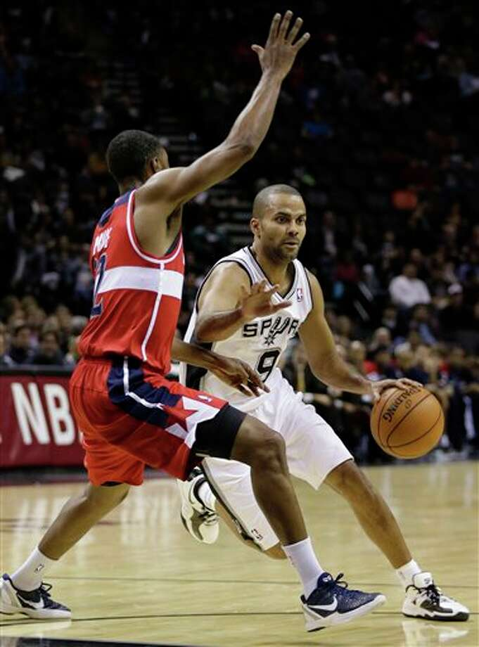 San Antonio Spurs' Tony Parker (9), of France, drives around Washington Wizards' A.J. Price, left, during the second quarter of an preseason NBA basketball game, Friday, Oct. 26, 2012, in San Antonio. (AP Photo/Eric Gay) Photo: Eric Gay, AP / AP