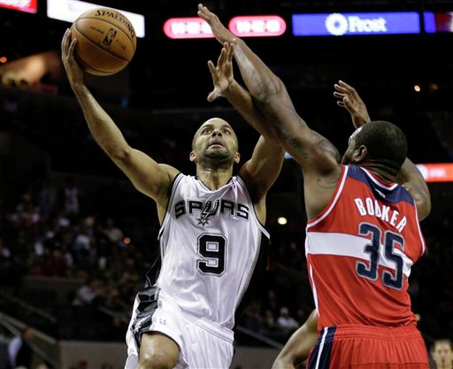 San Antonio Spurs' Tony Parker (9), of France, shoots around Washington Wizards' Trevor Booker (35) during the second quarter of an preseason NBA basketball game, Friday, Oct. 26, 2012, in San Antonio. (AP Photo/Eric Gay) Photo: Eric Gay, AP / AP