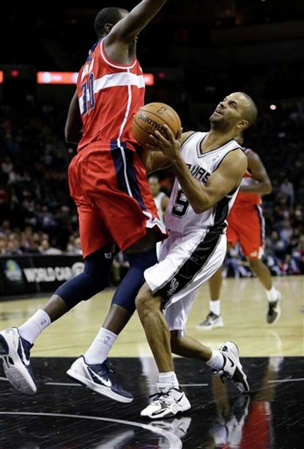 San Antonio Spurs' Tony Parker, right, of France, shoots around Washington Wizards' Earl Barron (30) during the first quarter of an preseason NBA basketball game, Friday, Oct. 26, 2012, in San Antonio. (AP Photo/Eric Gay) Photo: Eric Gay, AP / AP