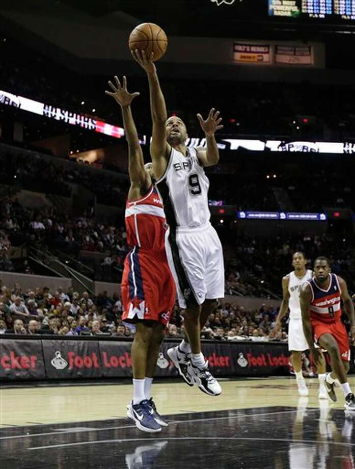 San Antonio Spurs' Tony Parker (9), of France, during the second quarter of an preseason NBA basketball game against the Washington Wizards, Friday, Oct. 26, 2012, in San Antonio. (AP Photo/Eric Gay) Photo: Eric Gay, AP / AP