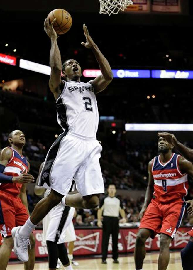 San Antonio Spurs' Kawhi Leonard (2) shoots during the first quarter of an preseason NBA basketball game against the Washington Wizards, Friday, Oct. 26, 2012, in San Antonio. (AP Photo/Eric Gay) Photo: Eric Gay, AP / AP