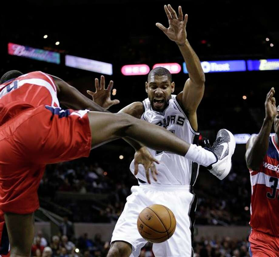 San Antonio Spurs' Tim Duncan, right, loses control of the ball as Washington Wizards' Martell Webster, left, defends during the first quarter of an preseason NBA basketball game, Friday, Oct. 26, 2012, in San Antonio. (AP Photo/Eric Gay) Photo: Eric Gay, AP / AP