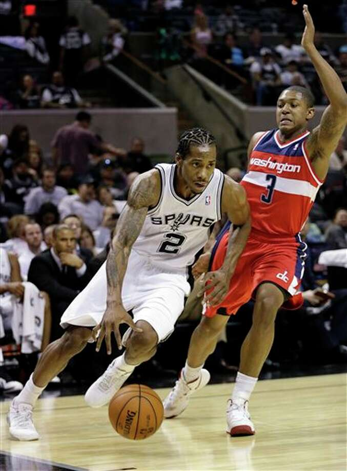 San Antonio Spurs' Kawhi Leonard (2) drives past Washington Wizards defender Bradley Beal (3) during the first quarter of an preseason NBA basketball game, Friday, Oct. 26, 2012, in San Antonio. (AP Photo/Eric Gay) Photo: Eric Gay, AP / AP