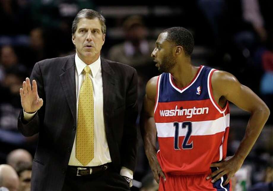 Washington Wizards' A.J. Price (12) talks with head coach Randy Wittman, left, during the first quarter of an preseason NBA basketball game against the San Antonio Spurs, Friday, Oct. 26, 2012, in San Antonio. (AP Photo/Eric Gay) Photo: Eric Gay, AP / AP