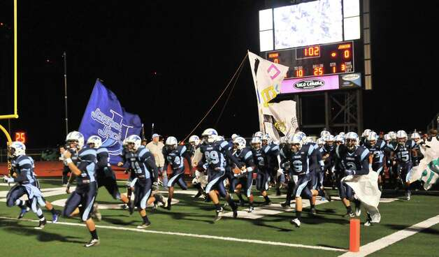 The Johnson Jaguars take the field for their game versus Reagan Friday night. Photo: Express-News