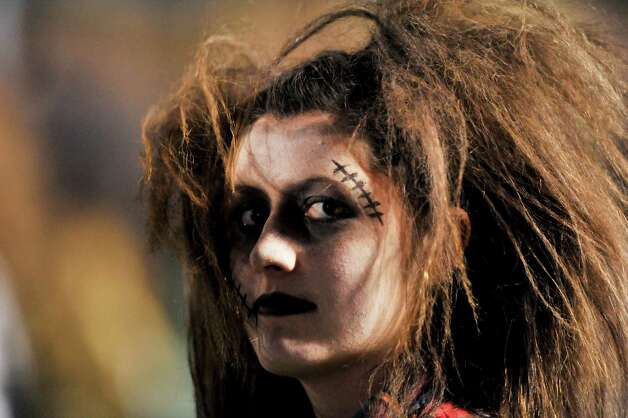 "Emioly Hale, a senior member of the Reagan High School Dancers,  sports zombie make-up for the troupe's performance of ""Thriller"" at half time of the Reagan versus Johnson game Friday night. Photo: Express-News"