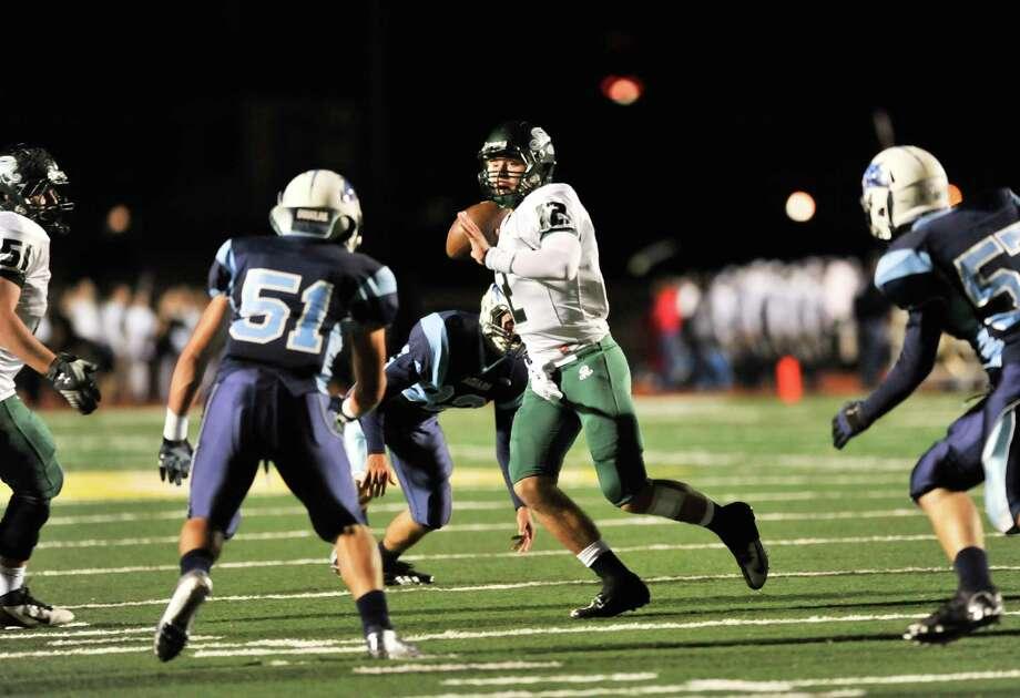 Reagan quarterback Kyle Keller scrambles to look for a receiver versus Johnson Friday night. Photo: Express-News