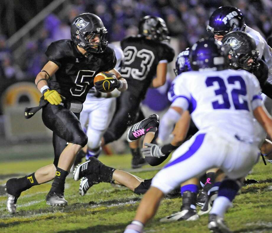 Pirate #5, Thomas Novak, left, looks for an opening to run through as he heads upfield for a gain. The Vidor High School Pirates hosted the Port Neches-Groves Indians football team Friday night October 26, 2012 at Pirate Stadium.  Dave Ryan/The Enterprise Photo: Dave Ryan