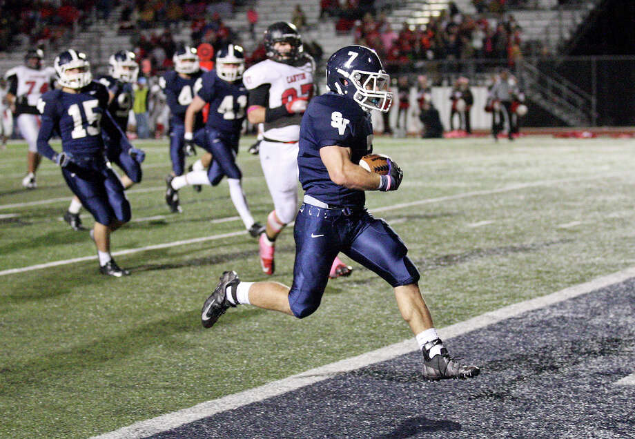 Smithson Valley's Diego Hodges scores a touchdown on an interception against New Braunfels Canyon during second half action Friday Oct. 26, 2012 at Ranger Stadium in Spring Branch, Tx. Smithson Valley won 35-3. Photo: Edward A. Ornelas, Express-News / © 2012 San Antonio Express-News