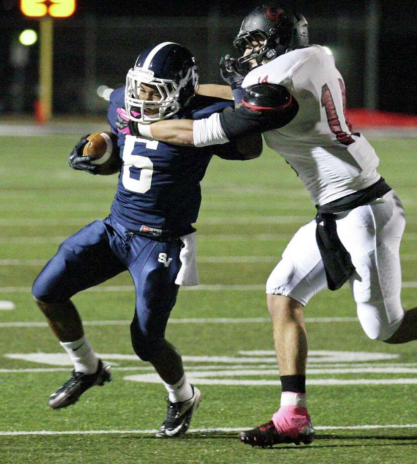 Smithson Valley's Xavier Coombs tries to shake the tackle of New Braunfels Canyon's Evan Wright during first half action Friday Oct. 26, 2012 at Ranger Stadium in Spring Branch, Tx. Photo: Edward A. Ornelas, Express-News / © 2012 San Antonio Express-News