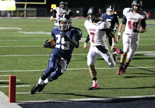 Smithson Valley's Cameron Jones heads to the end zone for a touchdown around New Braunfels Canyon's Philip Shelton during first half action Friday Oct. 26, 2012 at Ranger Stadium in Spring Branch, Tx. Photo: Edward A. Ornelas, Express-News / © 2012 San Antonio Express-News