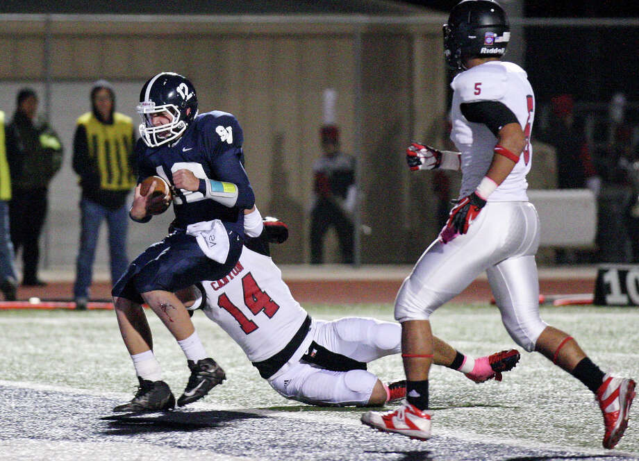 Smithson Valley's Garrett Smith scores a touchdown around New Braunfels Canyon's Evan Wright as New Braunfels Canyon's Xavier Vaillant looks on during first half action Friday Oct. 26, 2012 at Ranger Stadium in Spring Branch, Tx. Photo: Edward A. Ornelas, Express-News / © 2012 San Antonio Express-News
