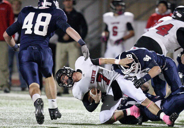 New Braunfels Canyon's Philip Shelton is sacked by Smithson Valley's Sebastian Sanchez and Austin Pierce as Smithson Valley's Mason Nasis moves in on the play during first half action Friday Oct. 26, 2012 at Ranger Stadium in Spring Branch, Tx. Photo: Edward A. Ornelas, Express-News / © 2012 San Antonio Express-News