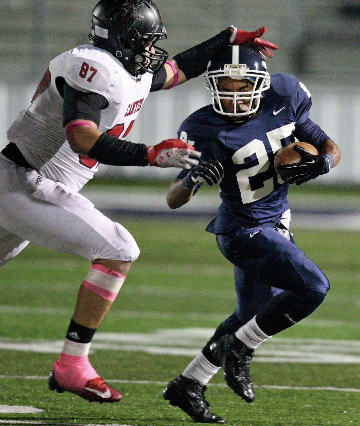 Smithson Valley's Cameron Jones looks for running room around New Braunfels Canyon's Ernest Gonzales during first half action Friday Oct. 26, 2012 at Ranger Stadium in Spring Branch, Tx.
