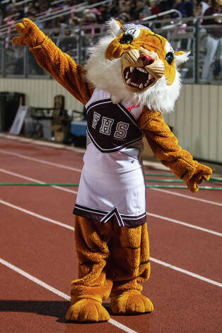 The Floresville Lion cheers on the sideline during their game with Medina Valley at Eschenberg Field in Flooresville on Oct. 26, 2012.  Medina Valley beat the Tigers 27-13.  MARVIN PFEIFFER/ mpfeiffer@express-news.net Photo: MARVIN PFEIFFER, Express-News / Express-News 2012