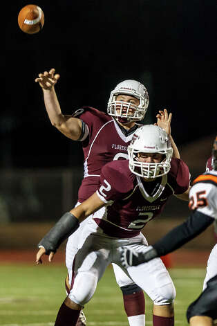Floresville quarterback Colby Shodrock gets off a pass as Cainan Payne stays in to block during the fourth quarter of their game at Eschenberg Field in Flooresville on Oct. 26, 2012.  Medina Valley beat the Tigers 27-13.  MARVIN PFEIFFER/ mpfeiffer@express-news.net Photo: MARVIN PFEIFFER, Express-News / Express-News 2012