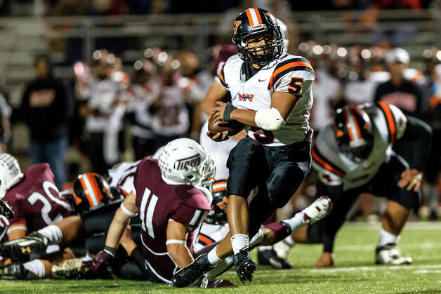 Medina Valley's Ben Mata breaks throuh the Floresville line for a nice gain during the third quarter of  their game at Eschenberg Field in Flooresville on Oct. 26, 2012.  Mata rushed for 194 yards on 33 carries scoring a toudhdown and a two-point conversion to help the Panthers beat Floresville 27-13.  MARVIN PFEIFFER/ mpfeiffer@express-news.net Photo: MARVIN PFEIFFER, Express-News / Express-News 2012