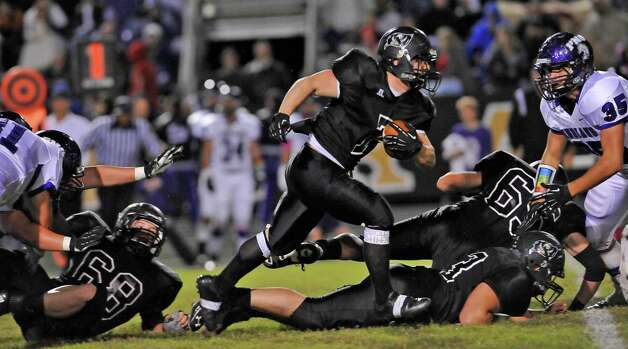 Pirate #7, Justin Moore, center, blows through an opening in the PN-G defense made by his teammates.   The Vidor High School Pirates hosted the Port Neches-Groves Indians football team Friday night October 26, 2012 at Pirate Stadium.  Dave Ryan/The Enterprise Photo: Dave Ryan