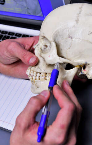 Elan Lee, a first year dental student, looks over notes about skull  anatomy at the University of Texas Health Science Center at San Antonio  on Oct. 22, 2012. Photo: Robin Jerstad, For The Express-News