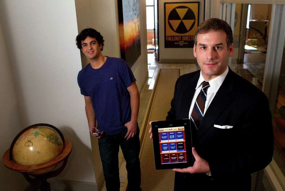 "Alex Torry, left, is PushLegal's chief operating officer. Jonathan Paull is its founder. ""You can store an entire law library on your smartphone,"" Torry says. Photo: Brett Coomer, Houston Chronicle / © 2012 Houston Chronicle"