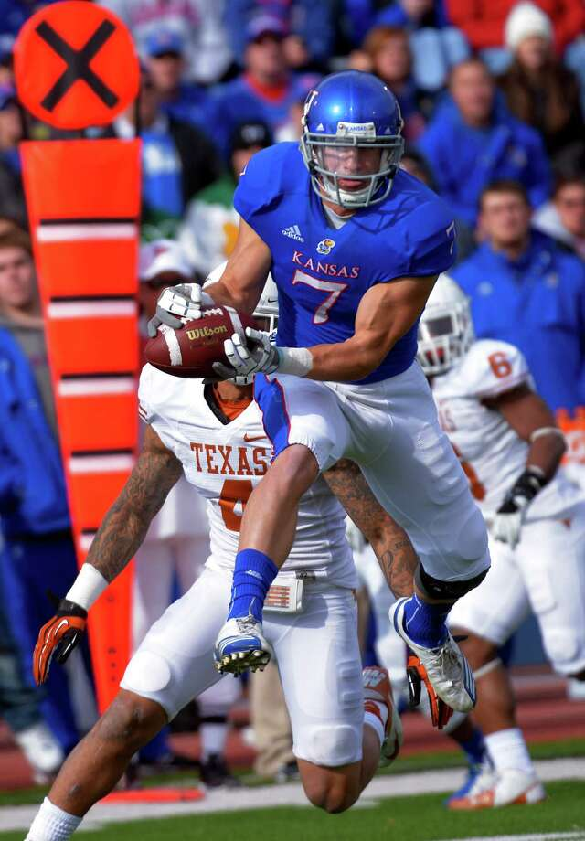 Kansas wide receiver Kale Pick (7) makes this catch in front of Texas safety Kenny Vaccaro (4) during the first half of an NCAA college football game in Lawrence, Kan., Saturday, Oct. 27, 2012. (AP Photo/Reed Hoffmann) Photo: Reed Hoffmann, Associated Press / FR48783 AP
