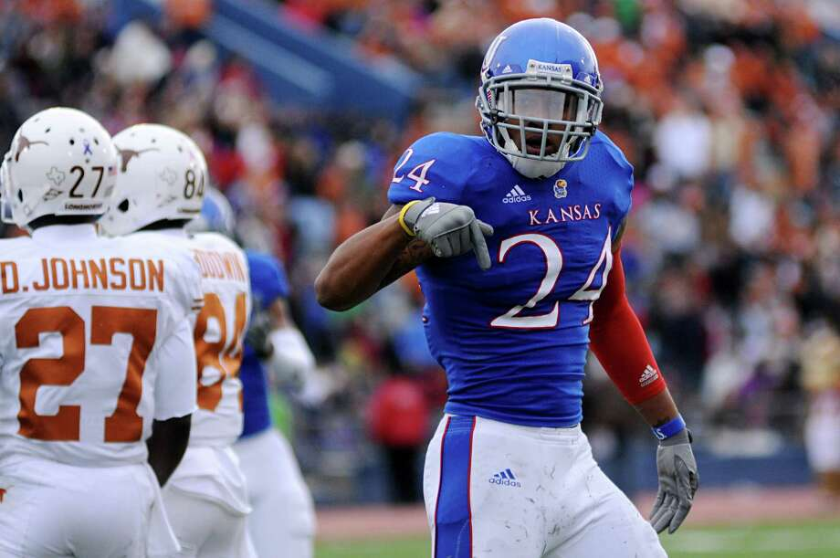 Kansas safety Brandon McDougald reacts after making a tackle against the Texas during the first half of NCAA football game, Saturday, Oct. 27,2 012, in Lawrence, Kansas. (AP Photo/The Daily Texan, Lawrence Peart) Photo: Lawrence Peart, Associated Press / The Daily Texan
