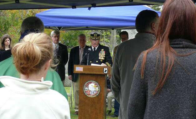 Roger Crossland, a retired U.S. Navy captain, addresses gathering Saturday to mark the rededication of the restored headstone for Capt. Samuel Smedley in the Old Burying Grounds. Photo: Genevieve Reilly