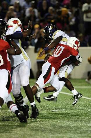 Lamar linebacker Jermaine Longino will not let PV A&M quarterback De'Auntre Smiley breathe in the back field at Provost Umphrey Stadium on Saturday, September 8, 2012. Photo taken: Randy Edwards/The Enterprise