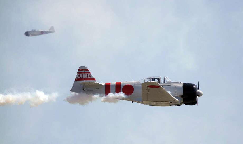 Zero's perform in Tora, Tora, Tora commemorative airshow during The 28th Annual Wings Over Houston Airshow at  Ellington Field on Saturday, Oct. 27, 2012, in Houston. Photo: Mayra Beltran, Houston Chronicle / Houston Chronicle