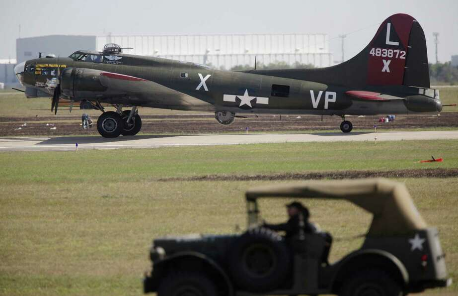 A B-17 lands safely during The 28th Annual Wings Over Houston Airshow at  Ellington Field on Saturda