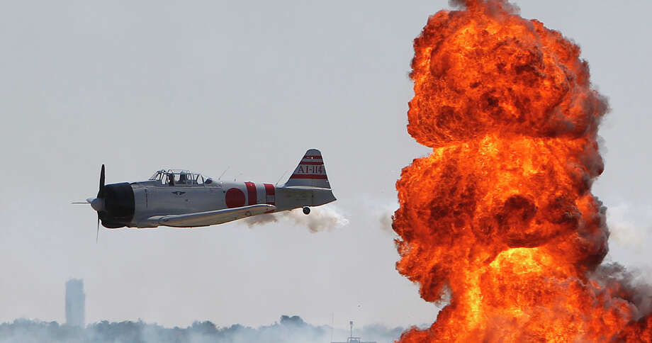 Japanese Zeros perform in the Tora, Tora, Tora, re-enactment of the  attack on Pearl Harbor during the 28th Annual Wings Over Houston Airshow at  Ellington Field on Saturday, Oct. 27, 2012, in Houston. Photo: Mayra Beltran, Houston Chronicle / Houston Chronicle