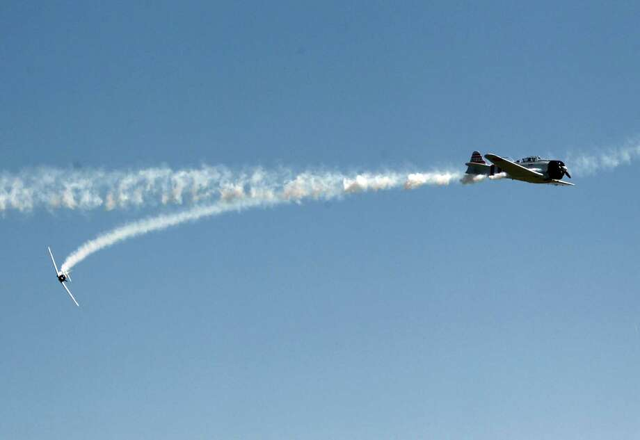 Japanese Zeros and torpedo bombers perform in the Tora, Tora, Tora, re-enactment of the  attack on Pearl Harbor during the 28th Annual Wings Over Houston Airshow at  Ellington Field on Saturday, Oct. 27, 2012, in Houston. Photo: Mayra Beltran, Houston Chronicle / Houston Chronicle