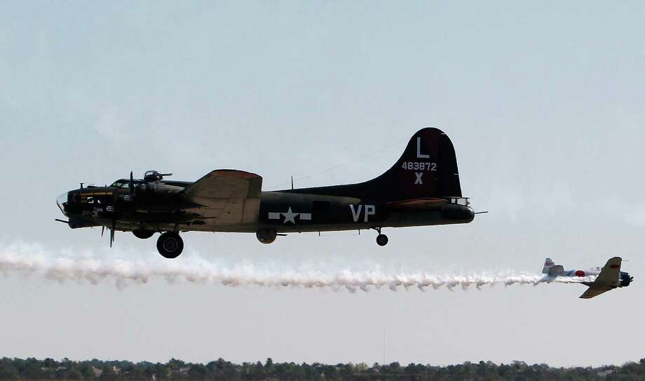 A B-17 performs during The 28th Annual Wings Over Houston Airshow at  Ellington Field on Saturday, Oct. 27, 2012, in Houston. Photo: Mayra Beltran, Houston Chronicle / Houston Chronicle