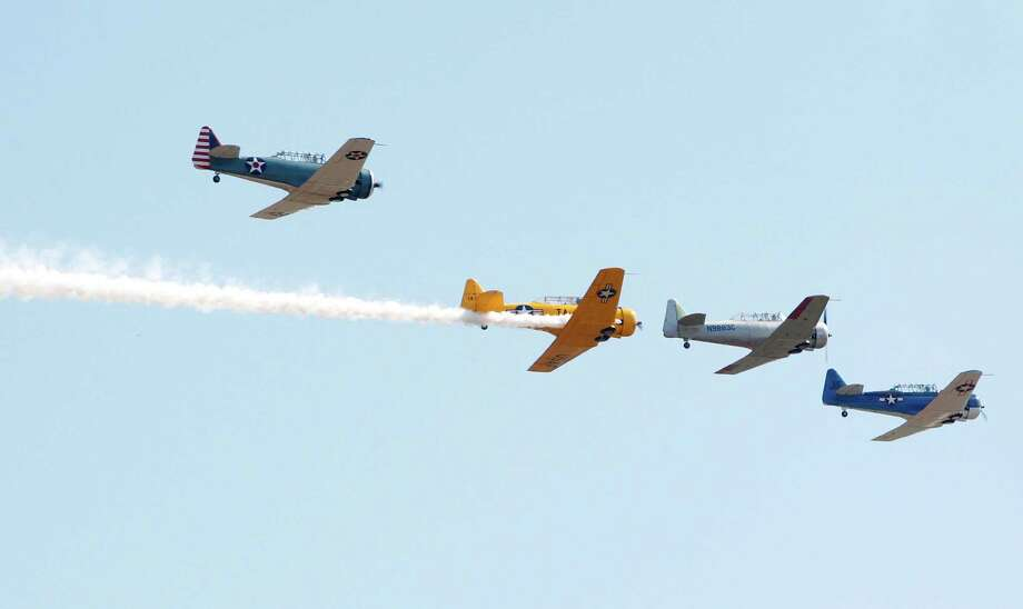 Training aircraft perform during the 28th Annual Wings Over Houston Airshow at Ellington Field on Saturday, Oct. 27, 2012, in Houston. Photo: Mayra Beltran, Houston Chronicle / Houston Chronicle