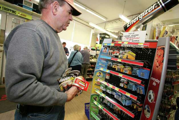 Old Greenwich resident Mike Poles stocks up on batteries at Feinsod Hardware Friday, Oct. 26, 2012, in preparation for Monday's possible storm. Photo: David Ames / Greenwich Time