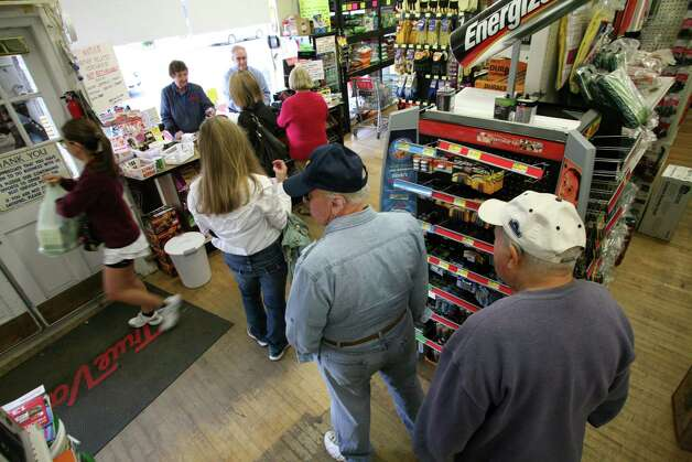 Customers lined up at Feinsod Hardware Friday, Oct. 26, 2012, to purchase emergency supplies for Monday's possible storm. Photo: David Ames / Greenwich Time
