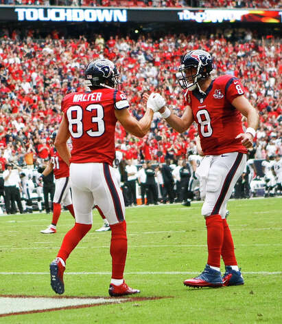 Houston Texans wide receiver Kevin Walter (83) gets a handshake from Houston Texans quarterback Matt Schaub (8) after he caught a touchdown pass during the first quarter of an NFL football game, Sunday, Oct. 21, 2012, at Reliant Stadium in Houston. Photo: Nick De La Torre, Houston Chronicle / Houston Chronicle