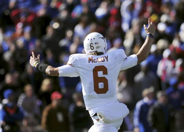 Texas quarterback Case McCoy celebrates after throwing the go-ahead touchdown against Kansas during the second half of NCAA football game, Saturday, Oct. 27,2 012, in Lawrence, Kansas. (AP Photo/The Daily Texan, Lawrence Peart) (Associated Press)