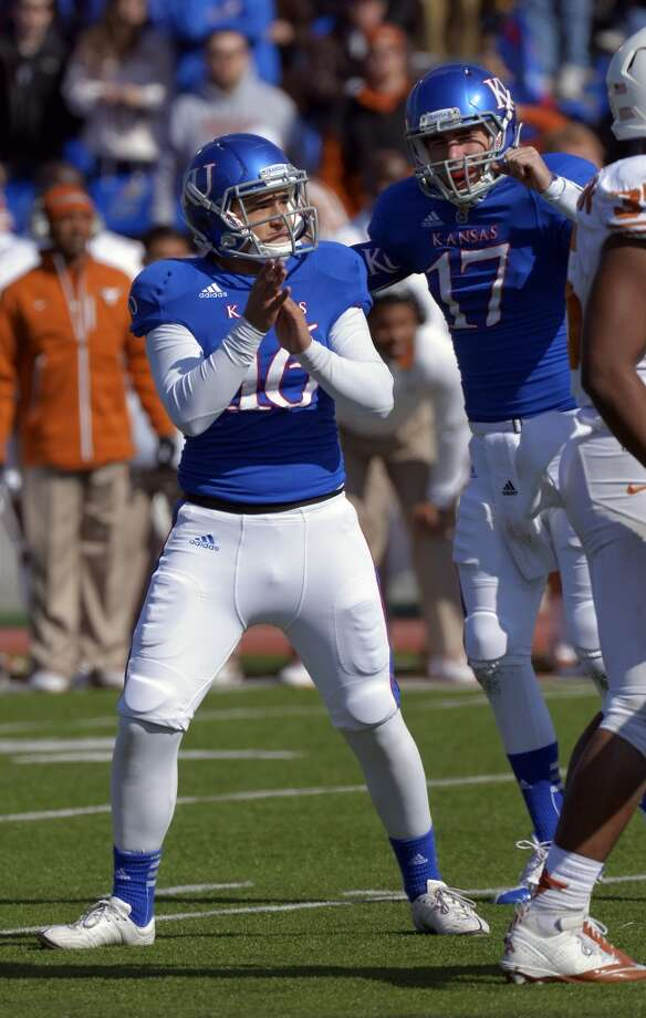 Kansas kicker Nick Prolago (16)  and Blake Jablonski (17) celebrate  Prolago's field goal against Texas during the second half of an NCAA college football game in Lawrence, Kan., Saturday, Oct. 27, 2012. (AP Photo/Reed Hoffmann) (Associated Press)
