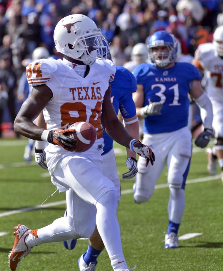 Texas wide receiver Marquise Goodwin (84) runs into the end zone for a touchdown against Kansas during the second half of an NCAA college football game in Lawrence, Kan., Saturday, Oct. 27, 2012. (AP Photo/Reed Hoffmann) (Associated Press)