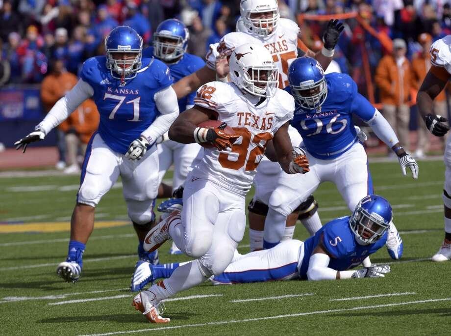 Texas running back Johnathan Gray (32) runs against Kansas during an NCAA college football game in Lawrence, Kan., Saturday, Oct. 27, 2012. (AP Photo/Reed Hoffmann) (Associated Press)