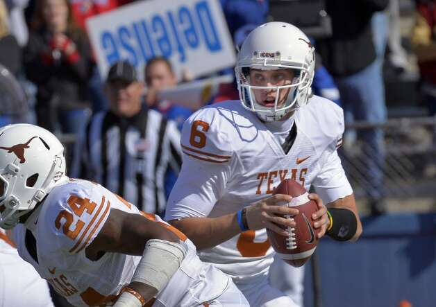 Texas quarterback Case McCoy (6) looks for Texas tight end D.J. Grant (18) in the end zone before throwing the game-winning touchdown pass against Kansas during the second half of an NCAA college football game in Lawrence, Kan., Saturday, Oct. 27, 2012. (AP Photo/Reed Hoffmann) (Associated Press)