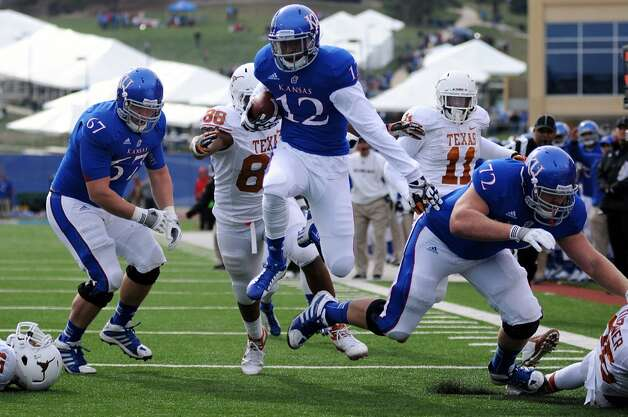 Kansas wide receiver Christian Matthews hurdles his way to the end zone for a touchdown against Texas during the first half of NCAA football game, Saturday, Oct. 27,2 012, in Lawrence, Kansas. (AP Photo/The Daily Texan, Lawrence Peart) (Associated Press)