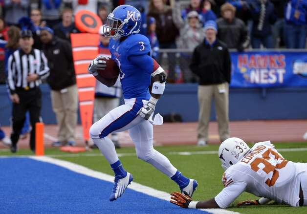 Kansas running back Tony Pierson (3) beats Texas linebacker Steve Edmond (33) for a touchdown during the first half of an NCAA college football game in Lawrence, Kan., Saturday, Oct. 27, 2012. (AP Photo/Reed Hoffmann) (Associated Press)