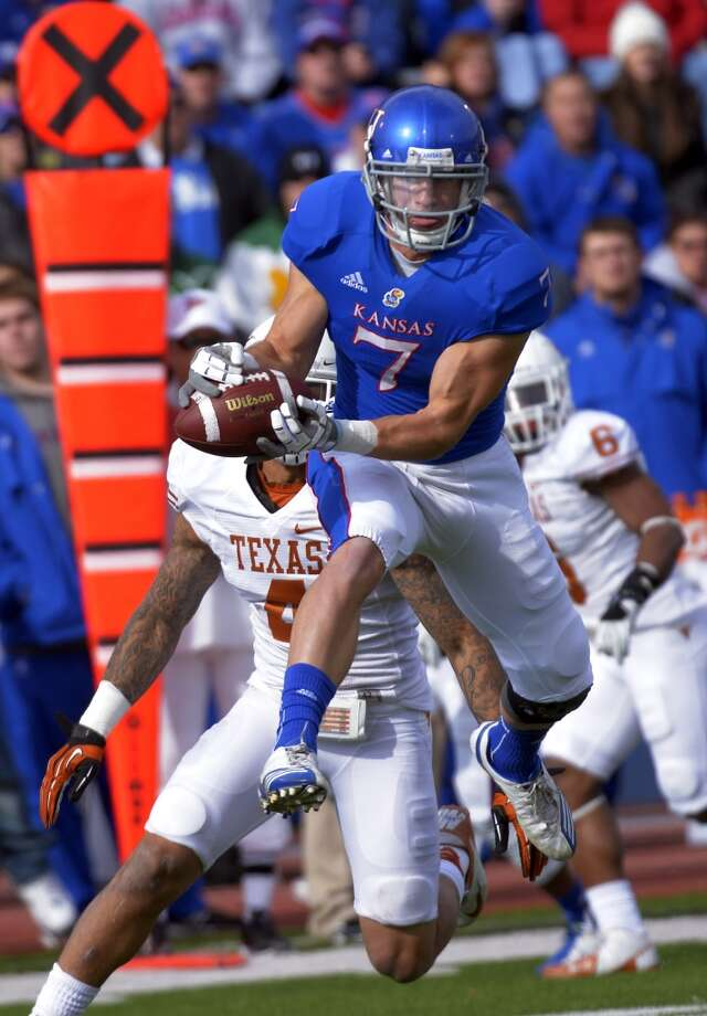 Kansas wide receiver Kale Pick (7) makes this catch in front of Texas safety Kenny Vaccaro (4) during the first half of an NCAA college football game in Lawrence, Kan., Saturday, Oct. 27, 2012. (AP Photo/Reed Hoffmann) (Associated Press)