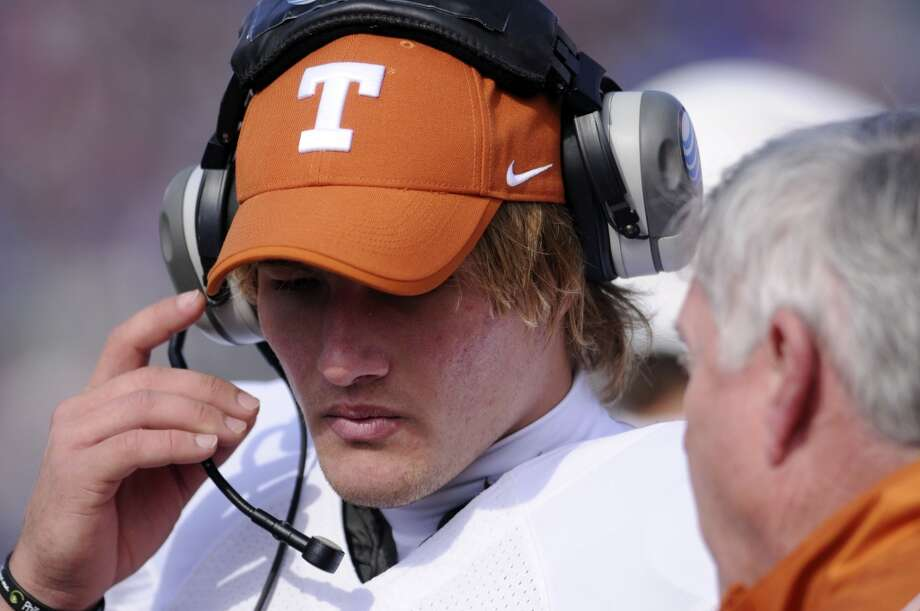Texas quarterback David Ash receives a word from head coach Mack Brown after being benched in the fourth quarter of NCAA football game against Kansas, Saturday, Oct. 27, 2012, in Lawrence, Kansas. (AP Photo/The Daily Texan, Lawrence Peart) (Associated Press)