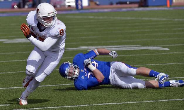 Texas wide receiver Jaxon Shipley (8) dodges Kansas linebacker Huldon Tharp (34) after making a catch during the second half of an NCAA college football game in Lawrence, Kan., Saturday, Oct. 27, 2012. (AP Photo/Reed Hoffmann) (Associated Press)