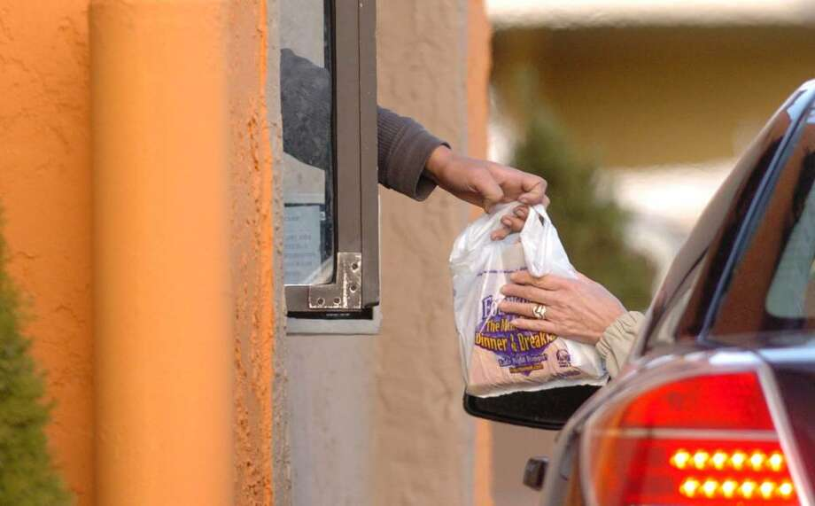 A customer recieves food from a fast food restaurant in Danbury, CT, Dec. 8, 2009. Photo: Chris Ware / The News-Times