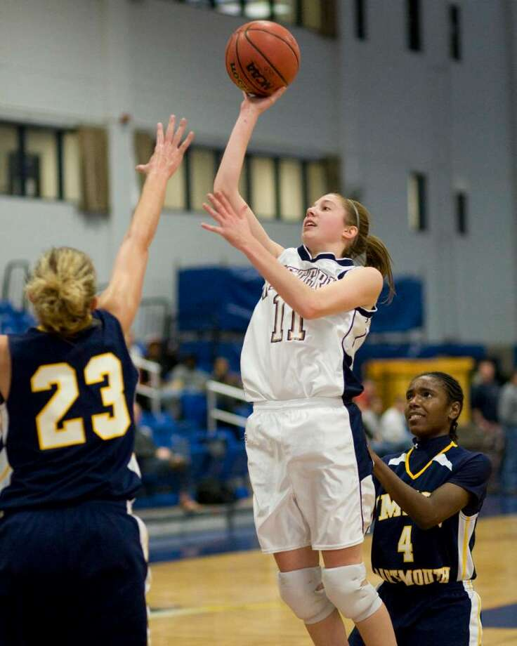 WestConn's StephanieSlonski (11) puts up a jump shot during the Colonials' LEC win over UMass-Dartmouth Saturday at the Feldman Arena. Photo: Barry Horn / The News-Times Freelance