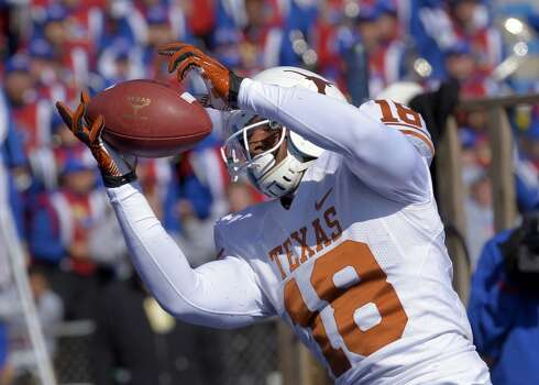 Texas tight end D.J. Grant (18) pulls in a pass for a touchdown late in the fourth quarter against the Kansas during an NCAA college football game in Lawrence, Kan., Saturday, Oct. 27, 2012. (AP Photo/Reed Hoffmann) (Associated Press)
